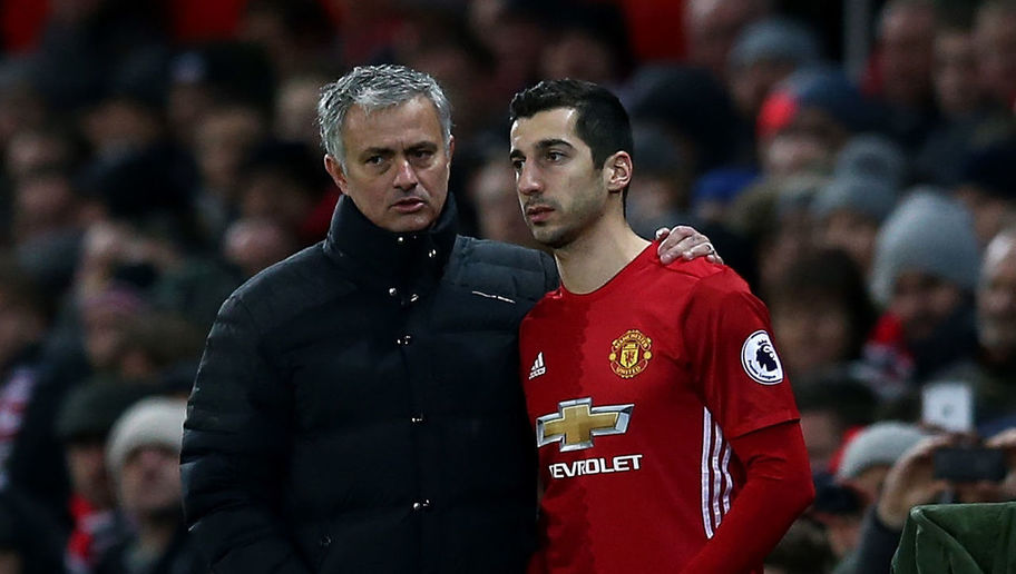 MANCHESTER, ENGLAND - DECEMBER 26: Manchester United manager Jose Mourinho speaks with Henrikh Mkhitaryan of Manchester United during the Premier League match between Manchester United and Sunderland at Old Trafford on December 26, 2016 in Manchester, England. (Photo by Jan Kruger/Getty Images)